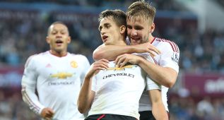 BIRMINGHAM, ENGLAND - AUGUST 14:  Adnan Januzaj of Manchester United celebrates scoring the first goal with team-mate Luke Shaw (R) during the Barclays Premier League match between Aston Villa and Manchester United at Villa Park on August 14, 2015 in Birmingham, United Kingdom.  (Photo by Matthew Peters/Man Utd via Getty Images)
