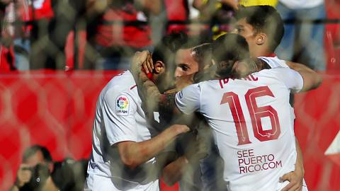 Sevilla's midfielder Pablo Sarabia (C) celebrates a goal with teammates during the Spanish league football match Sevilla FC vs RC Deportivo de la Coruna at the Ramon Sanchez Pizjuan stadium in Sevilla on April 8, 2017. / AFP PHOTO / CRISTINA QUICLER