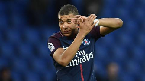 Paris Saint-Germain's French forward Kylian MBappe reacts at the end of the French Ligue 1 football match between Paris Saint-Germain and Angers at the Parc des Princes stadium in Paris on March 14, 2018.    / AFP PHOTO / FRANCK FIFE