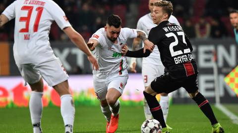 Augsburg (Germany), 26/04/2019.- Augsburg's Marco Richter in action against Leverkusen's Mitchell Weiser during the German Bundesliga soccer match between FC Augsburg and Bayer 04 Leverkusen in Augsburg, Germany, 26 April 2019. (Alemania) EFE/EPA/PHILIPP GUELLAND CONDITIONS - ATTENTION: The DFL regulations prohibit any use of photographs as image sequences and/or quasi-video.